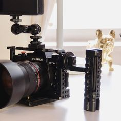 SmallRig Fuji Cage for Fujifilm Camera 1881 is a form-fitting but detachable cage, which protects your Fujifilm camera well. cage for video cage cage cage Fuji Camera, Camera Rig, Camera Angle, Camera Hot Shoe, Best Camera, Photography Gear, Camera Settings, Zeiss, Camera Accessories