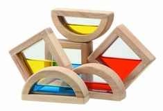 Plan Toy Water Blocks.  Mesmerizing to hold and rock back and forth, colorful to stack and hold up to light (Yellow + Blue = Green!), fun to add to basic building.