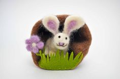 I love how this felted rabbit has a little home of its own!