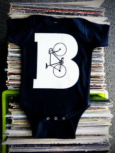 B is for Bike Black Baby Onesie by TrulySanctuary Great Baby Shower Gift, First Birthday Gift Or Party Favor. $15.99, via Etsy.