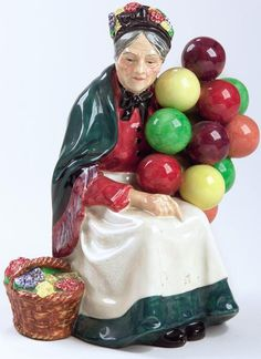 Royal Doulton Old lady selling balloons. I have this one anf the old man balloon seller as well.