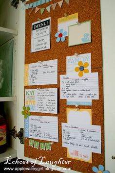 Kitchen Recipe board using cork tiles on the inside of a cabinet door.