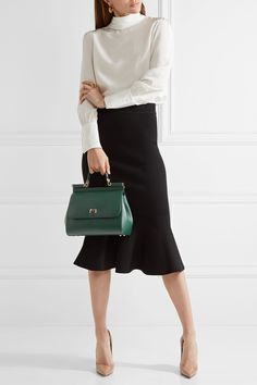 Dolce & Gabbana's iconic 'Sicily' tote is reworked in emerald for fall - the deepness of the shade makes it just as versatile as black bags. Made in Italy from textured-leather, it has a structured silhouette and optional shoulder strap for busy days. The leopard print-lined interior is complete with a zipped pocket and compact mirror.