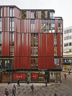 Terra-cotta tiles lend a strong vertical visual element to the South Molton Street Building in London by DSDHA. Glazed for a dark red hue, the tiles form irregular waves around the building's façade that break every so often to reveal glass or foliage.