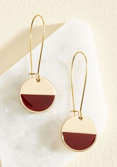 Take the edge off of finding the perfect accessory by adding these golden earrings into your adornment collection! Beautiful pendants of chic circles detailed with burgundy enamel characterize this dangling duo, which do laps around other pairs with their elegant design. With an emphasis on the beauty of handcrafted wares, Sonoma-based brand Beijo Brasil finds inspiration in truly unique aesthetics.