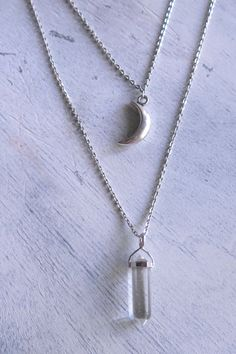 This lovely piece features one Clear Quartz Point crystal layered with a crescent moon in tibetan silver.  Clear Quartz is known as the Master