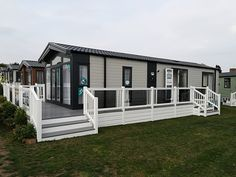 Fensys decking with bronzed toughened glass panels and driftwood grey deck board Plastic Fencing, Decking Panels, Decking Suppliers, Caravan Holiday, Led Manufacturers, Mobile Homes, Porch Ideas, Glass Panels, Driftwood