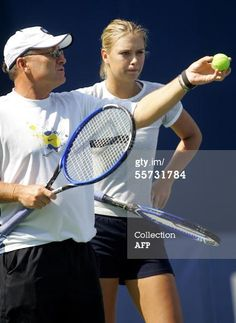 World number one player Maria Sharapova (R) listens to serving tips from her coach and father Yuri (L), 21 September 2005 at the Beijing Tennis Center in Beijing. Sharapova is top seed for the China Open and will begin play 22 September. AFP PHOTO/Frederic J. BROWN (Photo credit should read FREDERIC J. BROWN/AFP/Getty Images)