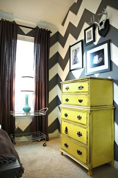 "Chevron wall! And painted furniture!  The wall looks like a lot of work, but it's stunning. I'd do thicker pattern with grey and purple on one wall and habe one of the purple ""stripes"" go across the whole room where the rest of the walls would be grey."