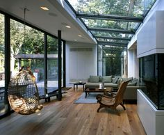 Love how the light can filter through different aspects.S wohnraum wintergarten verglaung holzboden hängekorbsessel Interior Architecture, Interior And Exterior, Interior Design, Conservatory Design, Glass House, Home And Living, Living Rooms, Living Spaces, My Dream Home