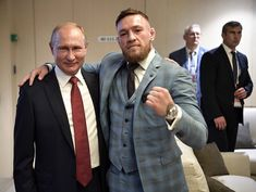 Conor McGregor and President Vladimir Putin are friends now. McGregor surprised the fans by appearing in World Cup Final in VIP Seat. The duo clicked some amazing pictures and had some conversations. Conor and Putin are both fans of each other. Conor Mcgregor Watch, Conor Mcgregor Haircut, Conor Mcgregor Suit, Mcgregor Suits, Mcgregor Fight, Connor Mcgregor, Karate Taekwondo, Tom Hardy Haircut, Mma Ufc