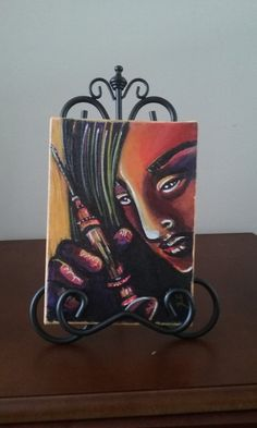 """""""Kiri, Kiri, Kiri"""" is an original affordable pocket sized painting by Krysta Logan. It depicts a young lady holding a syringe. This piece was inspired by Takashi Miike's amazing horror film Audition, which utilized lots of surreal scenes and bold colors that force the viewer to question the line between reality and psychosis.  This piece was created using acrylic paint and alcohol based marker on cotton canvas, and comes with a saw tooth hanger, making it ready to hang."""