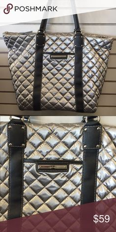Nine West Tote Nine West tote handbag features a quilted design, floral pattern, interior zipper pocket, interior slip pockets, exterior pocket, and a zipper closure. Handbag measures 20.5 in. x 13 in. x 8.5 in. Handle drop of 8.25 in. Rarely Used...Clean...No Wear & Tear Nine West Bags Totes