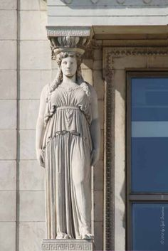 A caryatid (a female Greek figure used in place of a pillar) on the Field Museum facade, the Museum of Science and Industry in Jackson park has several too.