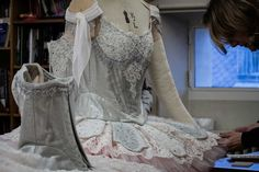 Applying Swarovski crystals to the lace by Maison Hallette for Lacroix's costumes for A Midsummer Night's Dream