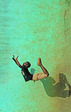 africanstories:  Cote d'Ivoire, Abidjan, boy jumping in the air © Art in All of Us /Anthony Asael (a Corbis photographer)
