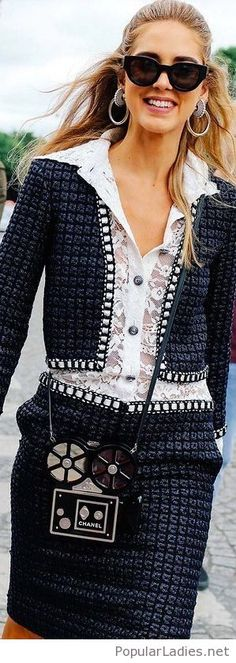 Interesting suit design with an awesome Chanel bag