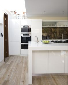 This Mannington Black Forest Oak laminate flooring is a sight for sore eyes in this newly renovated kitchen.