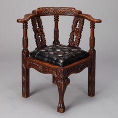 "Highly Carved English Corner Chair With Black Leather Seat  --  19th century English corner chair with elaborately carved frame and black leather tufted seat. Arm height is 28.75"" and seat is 18.5"" high and 24"" deep.  --   Item:  6507  --  Retail Price:  $2495"