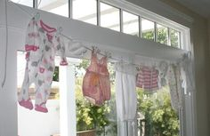 Cute idea! Onesies on a clothesline.