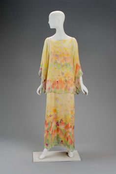 Day ensemble | Designed by Roy Halston Frowick, known as Halston (American, 1932-1990) | United States, early 1970's | Long yellow silk dress with scoop-neck and thin straps made out of beige rope. Fabric is hand-painted with abstract floral designs in blue, red, pink, and green | Matching blouse. Wide sleeves and wide boat neck. Material is more sheer, revealing dress underneath. Small slits at right and left seams | Museum of Fine Arts, Boston
