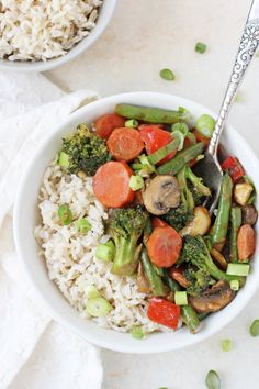 A fast, healthy & crunchy peanut ginger vegetable stir-fry! With colorful veggies and a crazy flavorful sauce, this recipe will be a family favorite!