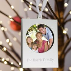 $17.59  Silver-toned frame ornament. Frame unsnaps opens to insert picture and is secured with a delicate ribbon.