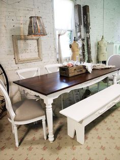 White dining room set with dark wood table top. Mis-matched chairs