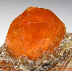 Orange Spessartine crystal in silvery, green Mica / Nani, Loliondo, Arusha Region, Tanzania
