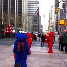 Only in NYC... Slightly scruffy, non-trademark, cartoon characters wandering around Midtown. Weird!