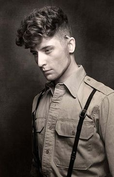 Shaved Sides with a Long, Curly Top on Haircuts for Men | Pictures of Mens Haircuts and Mens Hair Care & Shaving  http://haircutsformen.org/buzzblog/wp-content/gallery/pictures-of-mens-curly-haircuts/shaved-sides-with-curly-top.jpg