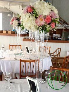Tall vases make flowers look amazing.