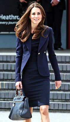 Kate, 29, showed off her super-slim physique in a sharp, navy blue woman's suit.  The Duchess wears Smythe's one-button Cutaway-Back Blazer in wool-crepe paired with the Manon Dress from Roland Mouret.