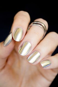 Modern metallic nails in silvery gold; futuristic minimalist nails