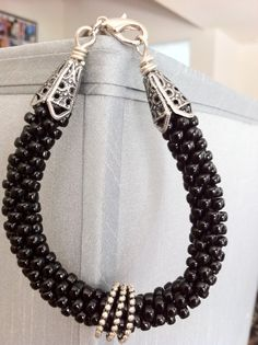 Love the black beads, and the use of 3 links in place of a pendant.