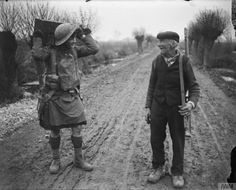 Defence of Hinges Ridge. A man of the 51st (Highland) Infantry Division and an elderly civilian, near Locon, 10 April 1918. © IWM (Q 6502)