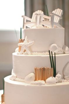 Wedding Cakes with a topper that completes the beachy feel