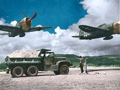 Seabee's repairing a runway on a Pacific island, while a pair of fighters fly by them...