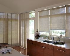 A harmony of window treatments that cover almost any kitchen window––Alustra® Skyline® Gliding Window Panels and Alustra® Woven Textures® Roller Shades ♦ Hunter Douglas window treatments - Pinned by Traditional Home New Trad Designer: Kristin Rocke Large Window Treatments, Kitchen Window Treatments, Window Coverings, Hunter Douglas, Sliding Patio Doors, Sliding Glass Door, Sliding Panels, Glass Doors, Shades Blinds