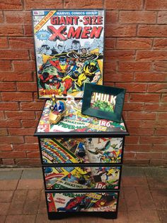 Bespoke Marvel Upcycled Bedside Table. Used black wood paint and decoupaged marvel paper on top, sides and drawers fronts. Sealed item with furniture varnish. Found on www.etsy.com/uk/shop/nineteen88furniture. Thanks for looking!