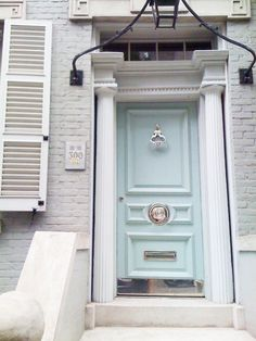 This front door reminds me of a Tiffany box! I think the inner side of a ladies office would suit this color.  I can not imagine a man would want this for his front door.