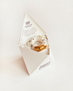 Amazing jewelry packaging -- love the sweet words.  Gold Glazed Milky Donut with Poppy Seeds Pendant by TADAM design