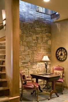 The Rivergate Custom Home - Basement: A rustic, natural stone-accented nook for the quiet reader or chess player is the perfect addition to any basement. (Home Design & Decor by B.L. Rieke & Associates, Inc.) #luxuryhome #natural stone #readingnook #nook #rustic #dreamhome #customhome #homedesign Visit our website: http://www.blrieke.com/ Visit our #Houzz page: http://www.houzz.com/pro/blrieke/
