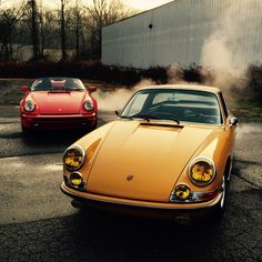 The classic Porsche 911 warming up on a cold winter morning. Love the gold tinted headlights.