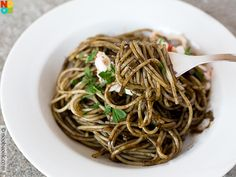 Easy recipe for Spaghetti al Nero di Seppia - pasta coated in a black and savoury squid (cuttlefish) ink sauce.