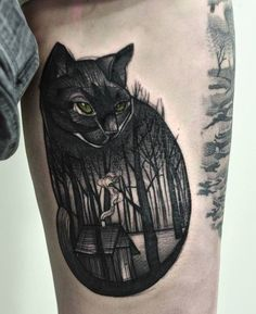 the image of a black cat is placed on the outer thigh