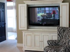 Our Family Room - Yellow Cape Cod I love armoires but they are so deep from the old TV style.  Would love one like this!