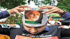 Modi's elevation as BJP's PM candidate evokes sharp reactions