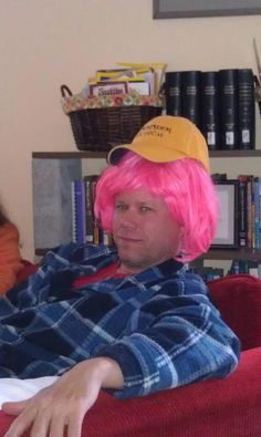 Me when Oreas made me wear one of her dress-up wigs on story night.