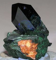 A very fine azurite crystal on malachite from Touissit. 1.0 x 7/8 x 1.0 inches. Ex: Lawrence Conklin Mineral Collecion.11/08 Copyright © 2006 Joseph A. Freilich, LLC. All Rights Reserved